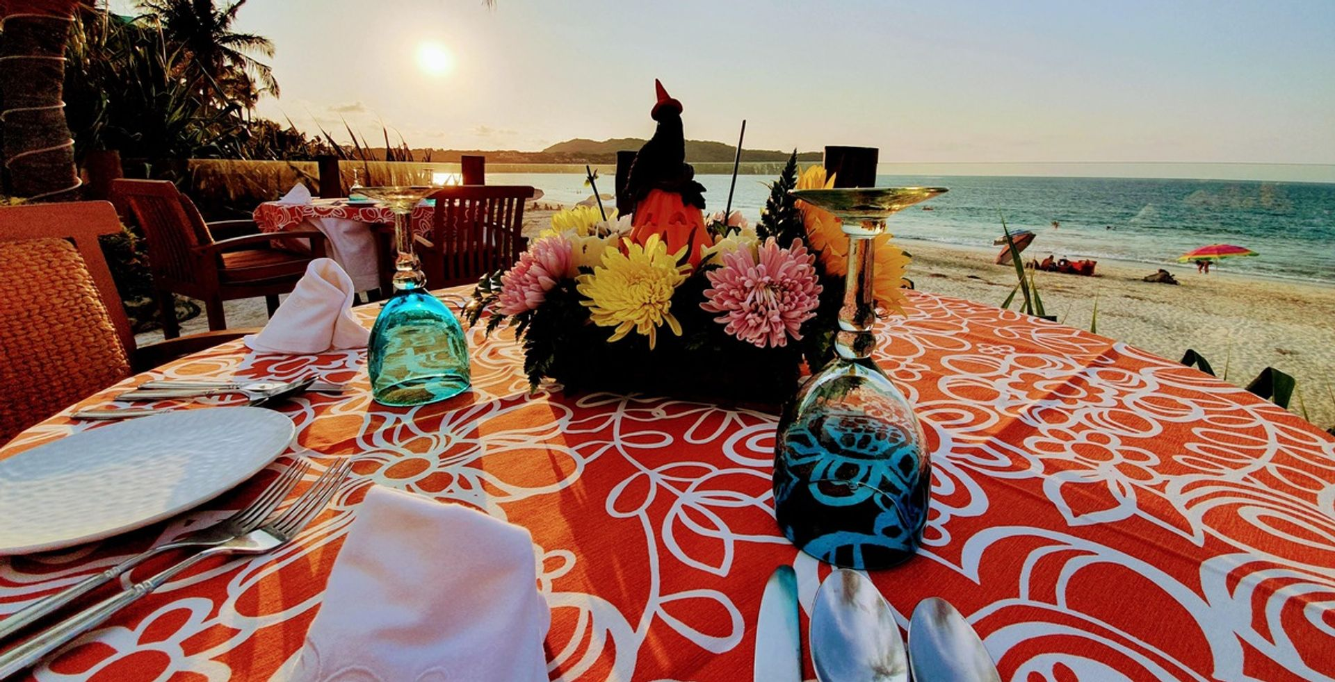 casa de mita dining red table cloth ocean view